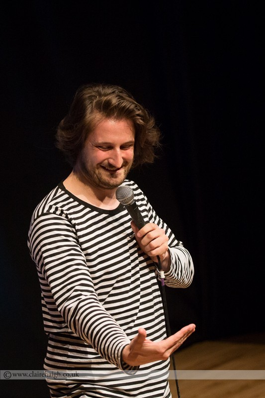 Alex Bennett performing at Jesterlarf New Act Showcase at Cambridge Junction as part of the Cambridge Comedy Festival